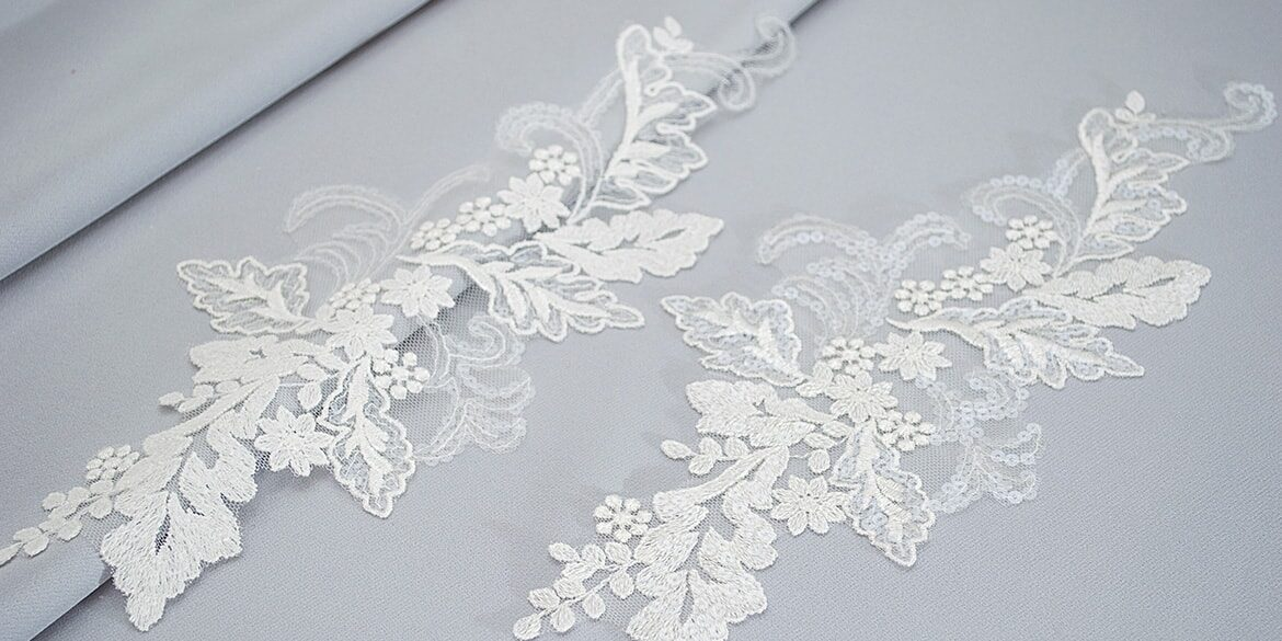 Sequined lace motifs