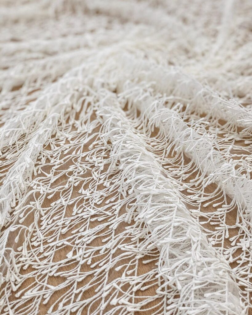 Ткань с бахромой